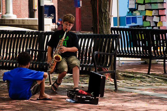 Kid playing saxophone