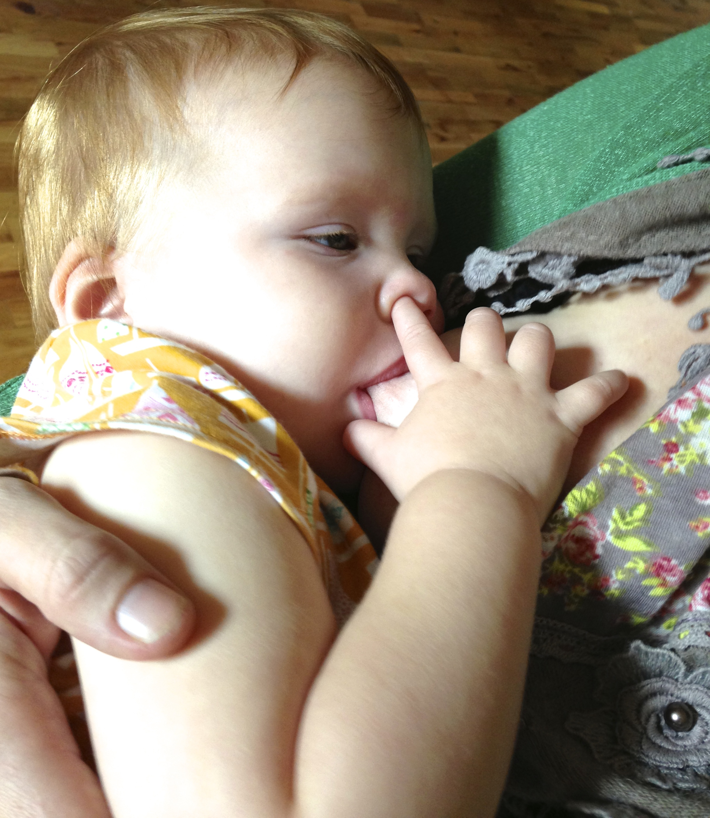 Toddlers are expert multitaskers at the breast.
