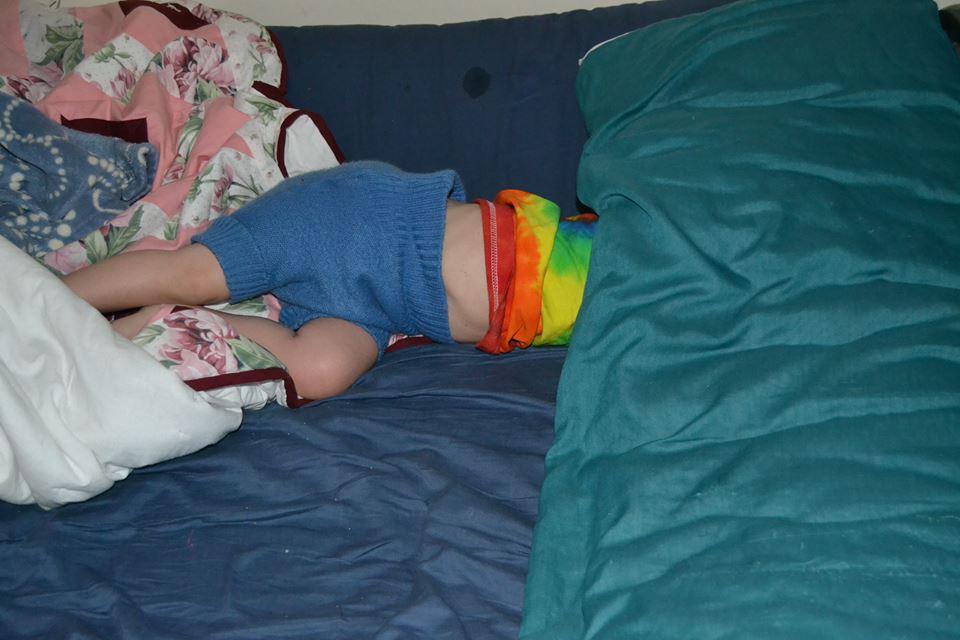 sleeping burrowed under blankets