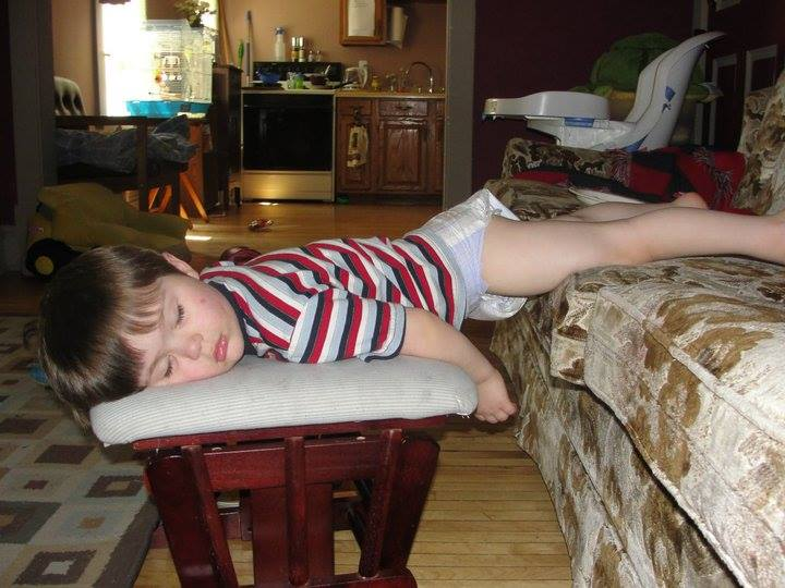 sleeping on couch and stool