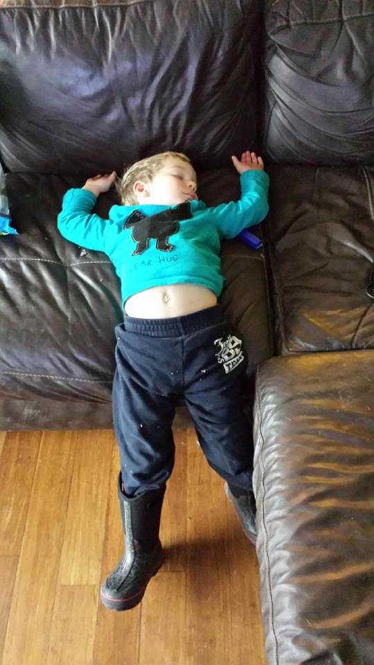 sleeping standing against the couch