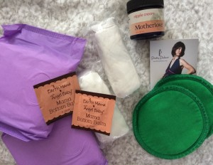 Mama care: pads, disposable underwear (there were 3 in the pack, 2 are shown), Earth Mama Angel Baby's Mama Bottom Balm, Motherlove nipple cream, and breast pads. You're literally taken care of from top to bottom.