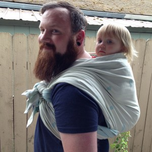 Pixie Hobbit in a ruck carry with a tibetan tie-off using the Lark Glacier.